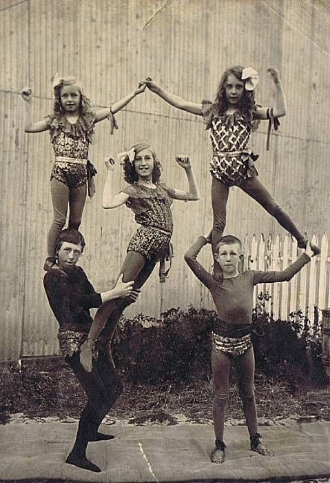 five youth circus performers pose in an historic photograph