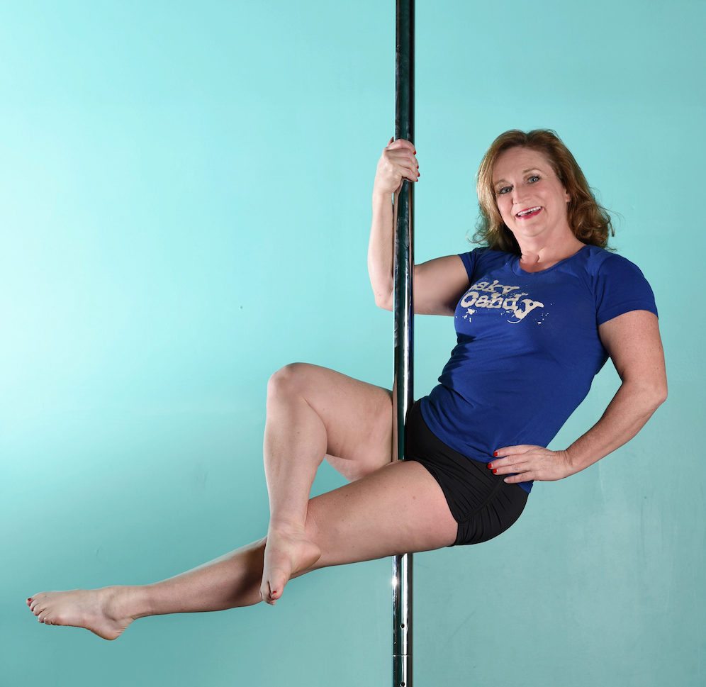 staff member poses on a pole