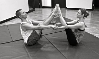 two people partner stretch on the ground