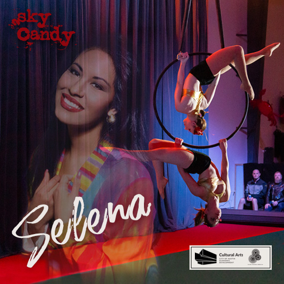 Projection of Selena smiling against a curtain while two female aerialists perform on an aerial hoop