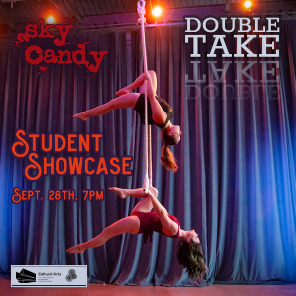 two female aerialists perform a duo act on trapeze to promote Sky Candy's student showcase